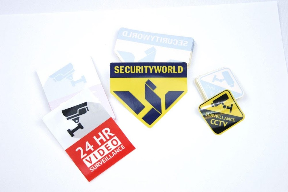 Front adhesive stickers of 3 different designs on a table