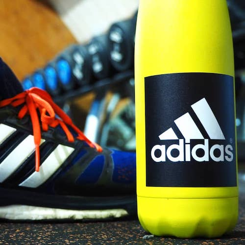 Matte square Adidas sticker applied to a water bottle