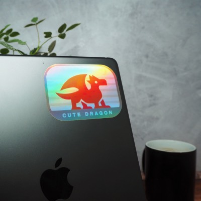 Cute dragon holographic sticker applied to an Apple iPad