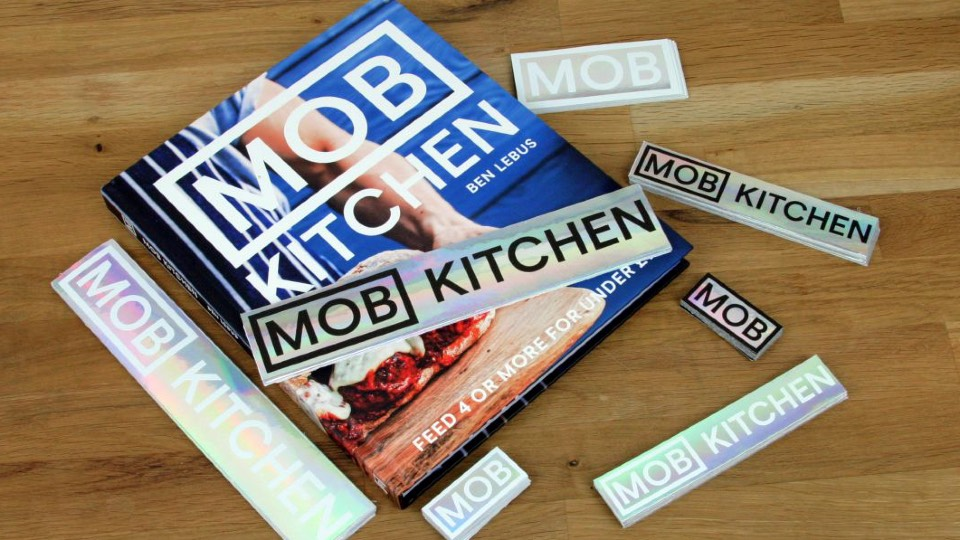 Mob kitchen book with holographic rectangular stickers on it