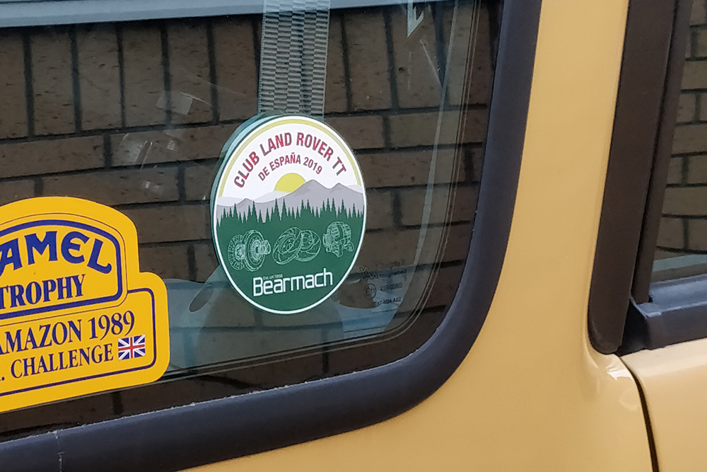 Circle Bearmach sticker with green on a sand colored vehicle