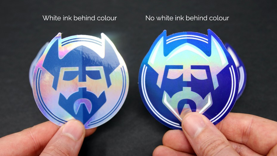 2 holographic stickers in hands 1 with no white ink, 1 with white ink