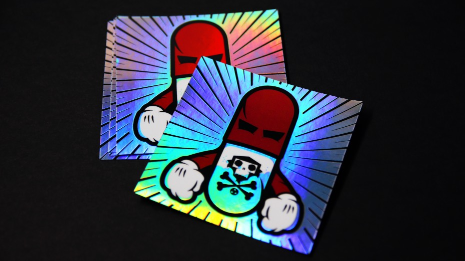 A pile of square holographic stickers on a black background