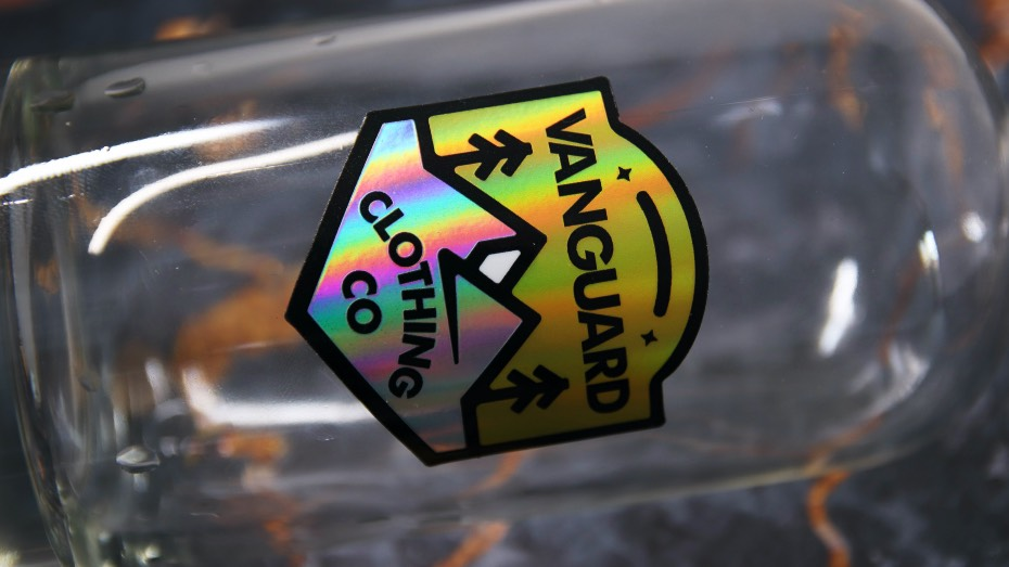 Holographic clothing sticker stuck to a bottle