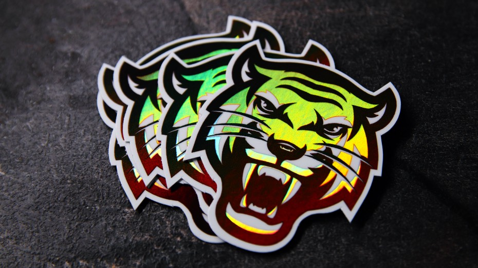 The face of a tiger, printed as a holographic sticker