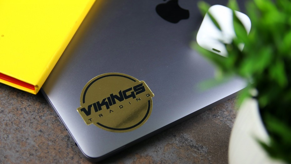 Mirror gold die cut sticker applied to a laptop