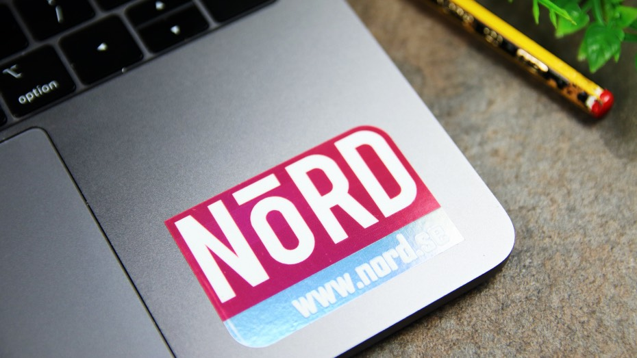 Holographic Nord die cut sticker applied to a laptop