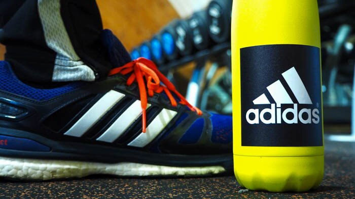 Black adidas white vinyl sticker on a water bottle at the gym