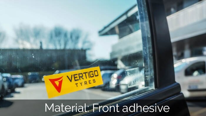 Front adhesive car window sticker applied to a car. windowin a car park