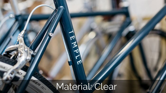 Temple Cycles blue bike with a clear rectangle sticker on a down tube