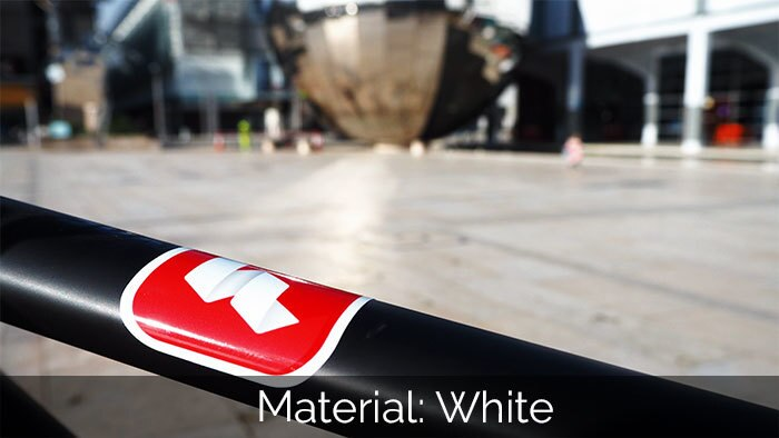 Red and white sticker with rounded corners on a black bike frame
