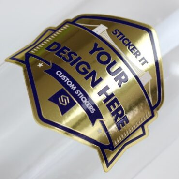 Mirror gold sticker applied to a glass bottle
