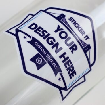 White vinyl sticker close up applied to a glass bottle