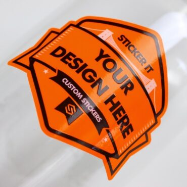 Neon orange sticker applied to a glass bottle
