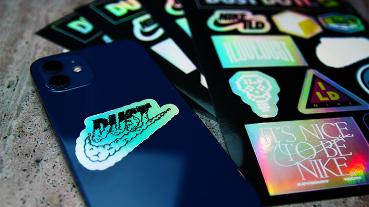 Nike holographic sheet labels with one label applied to a phone