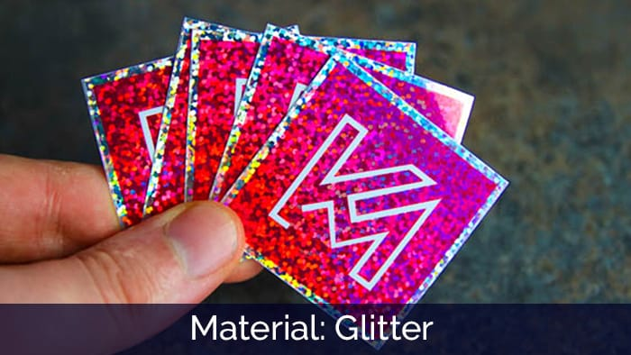 Pink and silver glitter KM stickers in hand