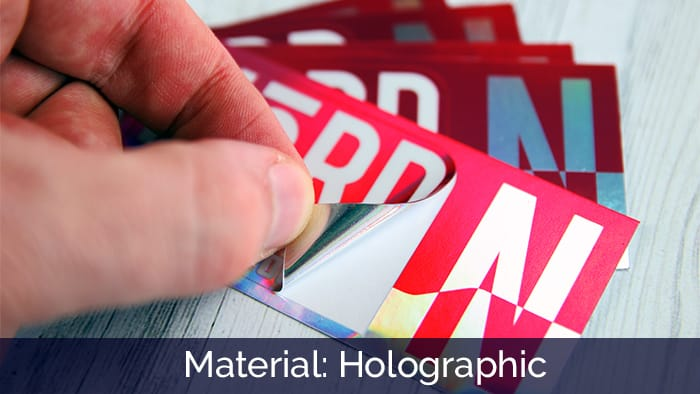 Holographic NORD kiss-cut sticker being peeled on a white background