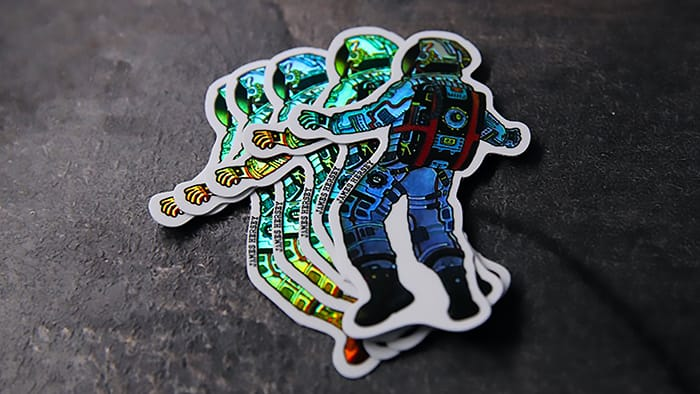 James Hersey Astronaut Die cut holographic stickers on a stone surface