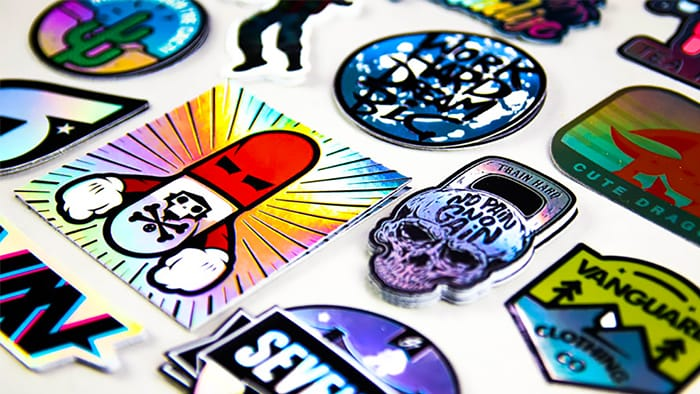 Stacks of holographic stickers on a white background