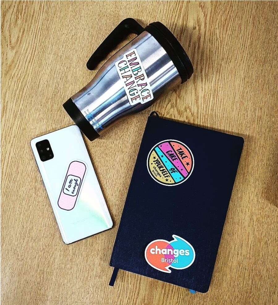 Mental Health stickers applied to laptop, phone and mug