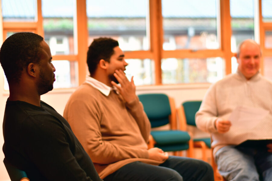 Men chatting in support group