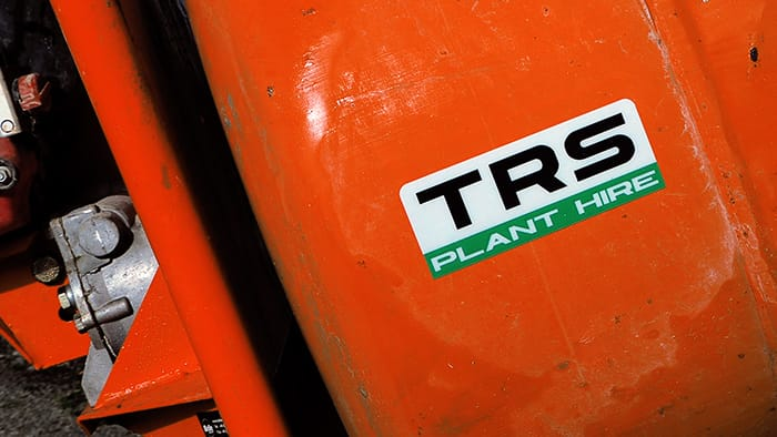 Rounded corner heavy duty plant hire sticker on an orsange cement mixer.