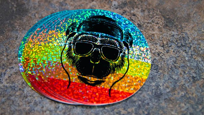 Colorful glitter circle monkey see stickers on a gray background