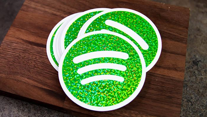 Spotify green glitter circle stickers on a wooden block