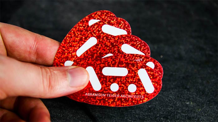 Red glitter oval stickers in a hand