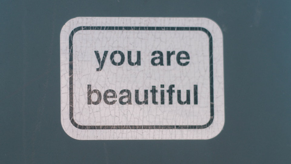 Your are beautiful sticker on dark background