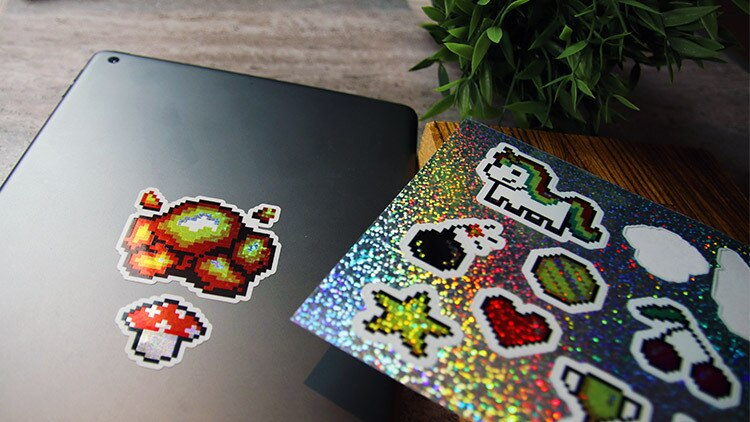 Glitter labels on sheets in full colour on an iPad on a stone table
