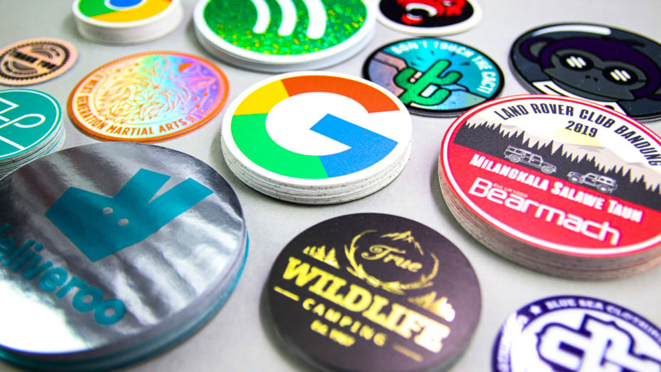 Stack of circular logo stickers on a white background