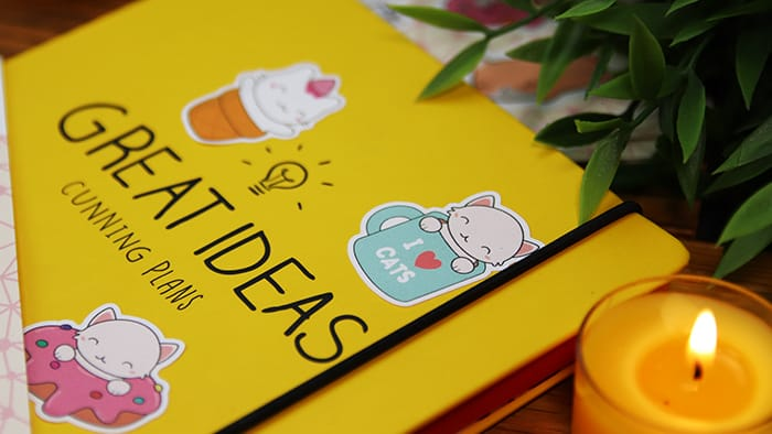 Cute custom die cut biodegradable paper stickers on yellow notepad